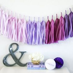 "Paper Tassel Garland - $35 Dimensions: approx. 10'L x 14""W Materials: tissue, twine Contents: 20 tassels per garland No assembly required"