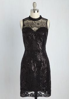 If praise is what you crave, then this black dress will do just the job! Highlighting the adventurous and admirable elements of your style with its gorgeous illusion neckline, scalloped accents, and glossy black sequins in a damask pattern, this LBD will quickly prove that applause comes standard!