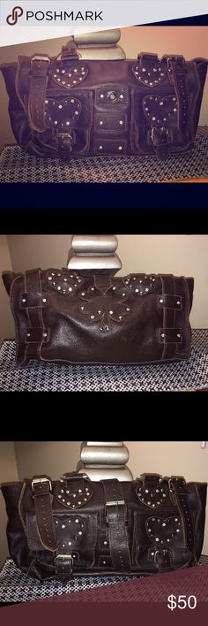 ⚡️REDUCED⚡️ Charm and Luck vintage handbag Old & rare Charm and Luck brown leather handbag with metal studding and rhinestones. Used condition but still a lovely bag. There's a stain on the inside packet that doesn't look like it will come out. Great add to a handbag collection. Charm and Luck Bags Satchels