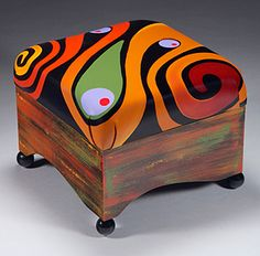 Upholstered leather ottoman by Anna Miles.