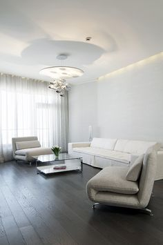 Apartment, Swivel Chairs Glass Coffee Table Chandelier Flower Vase Wooden Laminate Floor Curtain Glass Window And Long Cushion ~ Stylish Minimalist Apartment Ideas that Bring the Smart Decorating