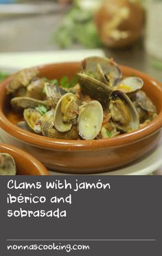 "Clams with jamón ibérico and sobrasada | ""I love clams. For something so small, they deliver tonnes of flavour punch and are so easy to cook. In Italy they're a bit purist about clams, mostly using them in fish stews and in pasta, but in Spain and Portugal they happily mix them with ham and pork – the little clam more than stands up for itself in the battle of big flavours. In the Madrid Mercado, I met Omaira, a chef who runs the café at the heart of this vibrant market. Omaira cooks some…"
