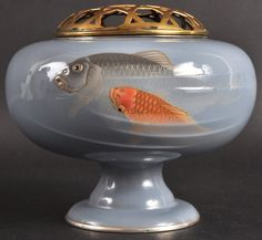 A SUPERB EARLY 20TH CENTURY JAPANESE CLOISONNE ENAMEL KORO AND COVER BY ANDO & CO decorated with two carp swimming. Signed. 6ins diameter. Aucitioned 2012 -£2,800.