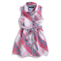 Tommy Hilfiger little girls' dress. Where's the party? Our plaid shirtdress is a social butterfly favorite with a floral flourish at the waistband. Moms will love it too in easy-to-care-for cotton.• 100% cotton.• Coordinating bloomer, tiny Tommy flag on hem.• Machine washable.• Imported.