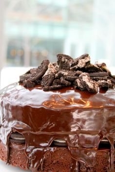 Betty Crocker Supermoist Devil's Food Cake Mix + Hershey's Special Dark Frosting +Chocolate sandwich cookies on top AND in the middle layer! Melt the frosting in the microwave for 20 seconds and pour over the top!