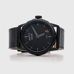 A watch that not only reminds you when it's time for that evening drink, but also helps you open it. Case: Brushed or black IP stainless steel, screw back case, 100M water resistant. Dial: Matte dial, raised Arabic markers, minute track, 3 hands. Crystal: Mineral. Crown: Stainless steel crown with Happy Hour enamel logo. Strap: Canvas with genuine leather lining. Buckle: Patented Happy Hour buckle. Movement: Japanese Miyota 2034. Please allow 2-3 weeks for shipping.