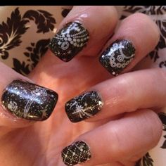 One of my 3.25.12 Challenge Manicures. Black and White theme my-mani-s