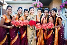 The Beautiful Bridesmaids At This Indian Wedding Wear Orange And Marsala Saris With Pink Bouquets For A Very Traditional Color Combination