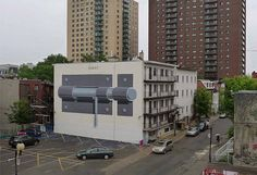 Spanish street artist Escif has created a mural of a giant door lock in Montreal, Canada.