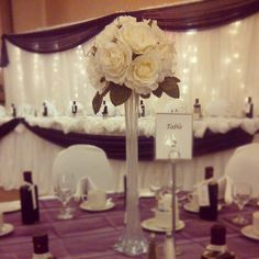 Beautiful white rose centre pieces for wedding reception.