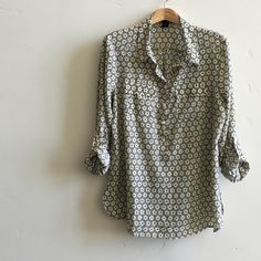 | Ann Taylor Shirt Beautiful navy, lemon and cream flower print, button down shirt.  Features pockets and roll up sleeves. Drapes beautifully.  100% polyester.  In like new condition. Ann Taylor Tops Button Down Shirts