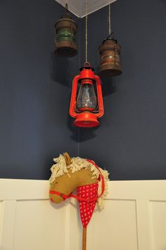 I like the lantern idea.Could put solar lights in them as long as they're close to a window during the day, would make a cool night light!