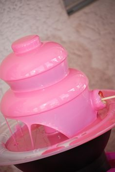 Chocolate Fountain . . .how did they make this pink!? Uuhh pink chocolate you can buy it at Michales or A.C Moore