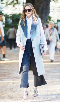 Olivia Palermo dresses up culottes with a trench coat + heels.