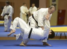 Putin practices with the Russian national judo team during a training session in Sochi on Jan. 8, 2016. Putin is passionate about judo, and has a black belt in it.