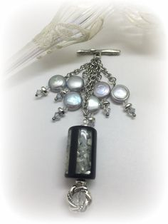 Crushed Mother of Pearl Beaded Pendant. Attach to available Stainless Steel or Leather Chains. Many more to choose from. Start your collection Today!
