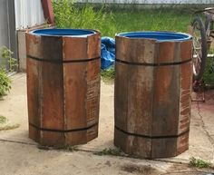 Plastic barrels to collect rain wrapped with strapping and panels for in barn. Plastic Barrel Planter, Plastic Planters, Wooden Planters, Solar Lighting System, Landscape Structure, Outside Furniture, Water Collection, Painting Plastic, Wood Boxes