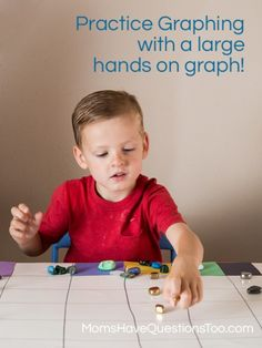 Graphing rocks on a large posterboard graph - A big hands on graph is perfect for preschoolers! Moms Have Questions Too