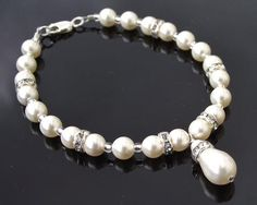 Very simply a lovely elegant teardrop pearl bracelet, especially for Brides not looking for a lot of sparkle, a single row of pearls with a teardrop pearl. Hair Jewelry, Wedding Jewelry, Jewellery, Crystal Bracelets, Pearl Bracelet, Wedding Earrings, Wedding Bracelets, Swarovski Pearls, Ear Piercings