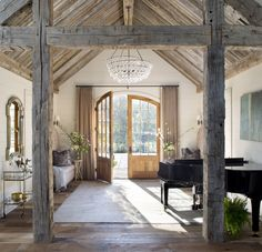 Rustic beams, statement-making chandelier, arched doors—this space has everything! (📸: Emily Minton Redfield, design by Post 31 Interiors) Grand Entryway, Rustic Entryway, Grand Entrance, Entryway Decor, Modern Farmhouse, Farmhouse Style, French Farmhouse, Rustic Modern, Farmhouse Kitchens