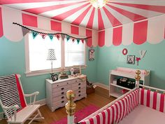Make the ceiling the focal point with fun striped wallpaper.