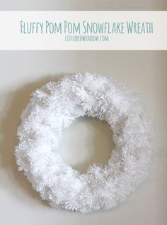 Beautiful, soft and fluffy DIY Pom Pom Snowflake Wreath with great instructions from littleredwindow.com! #winter #christmas #holidays #snow