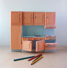 This could easily be made into a life size kitchen with cardboard boxes and paint
