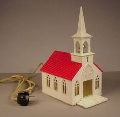 9.5in tall. Plays Silent Night. Vintage Christmas Church Light Up hard plastic 1950's building Village Musical