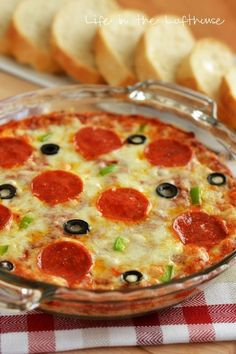 Warm Pizza Dip Recipe ~ Says: It's starts out with cream cheese then covered in pizza sauce. Next up, more cheese and all your favorite pizza toppings. I went traditional and used pepperoni, olives and green peppers, but you could really top this with any pizza toppings you love! This dip is such a perfect party appetizer!