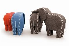 Elephant Ronny 25x20x10 cm Body made of 100% wool felt Laced by hand with cotton ribbons Available colours taubenblau, hellrot, grau meliert