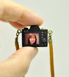 We challenge you to find a cuter custom gift than this tiny camera charm, made to order with the photo of your choice. (The detailed miniatures even come in dozens of real camera models!) See more options you'll want to snap right up in our personalized gifts shopping guide on the Etsy Blog. #etsygifts