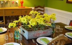 Take an old soda crate, put small mason jars in it.  Fill the jars up with water and flowers...great centerpiece.