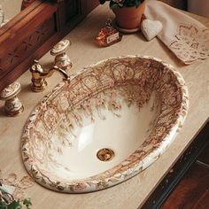 Gorgeous hand-painted china faucets & matching sink...