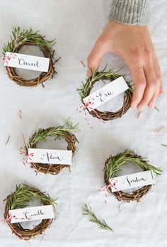 Adorable DIY rosemary wreaths for a holiday dinner party place card idea. So cute!