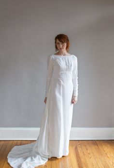 Unique and dramatic 1960s winter wedding gown. Sheath style gown made of a soft…