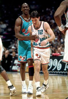 SAN ANTONIO - FEBRUARY 11:  John Stockton #12 of the Western Conference All Stars gets patted on on his chest by Michael Jordan #23 of the Eastern Conference All Stars during the 1996 NBA All Star Game played on February 11, 1996 at the Alamo Dome in San Antonio, Texas.  NOTE TO USER: User expressly acknowledges that, by downloading and or using this photograph, User is consenting to the terms and conditions of the Getty Images License agreement. Mandatory Copyright Notice: Copyright 1996…
