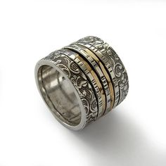 R1794  Floral wide band with spinners made of sterling silver and gold filled. It has a light feminine touch and lots of character. The main band is