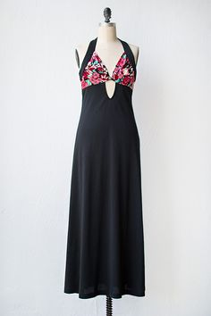 vintage 1970s black maxi dress with cut out