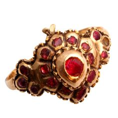 """Flat cut garnets set in 18k gold form the shape of a 'witches heart'. The witches heart was a romantic symbol of """"you have bewitched me"""". The ring would be categorized as Iberian as it's origin was Spain or Portugal. Circa 1700-1760"""