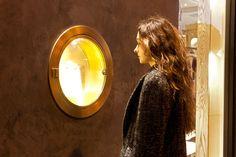 Kelly Wearstler peering into her flagship boutique on Melrose. Chocolate Venetian plaster.