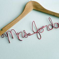 Personalized Wire Hanger. Cute for a Wedding Dress, or to nail it to the wall in the family room, or to hang it on your front door. $23