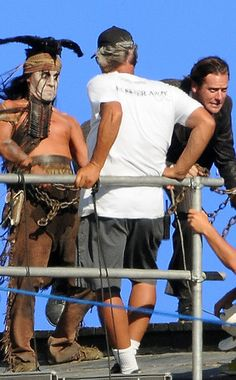 Johnny Depp and Armie Hammer on The Lone Ranger set. Haha. Their expressions are priceless!