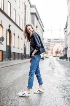 Ready, rain or shine. Trade rain boots for classic, white sneakers and true-blue denim. Top off your Levi's with an oversize black jean jacket.