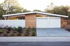 This Eichler remodel by Klopf Architecture, Arterra Landscape Architects, and Flegels Construction was well executed. My favorite element is how open the back of the house has become. The large slidin