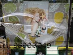 Welcome summer @ Churchills hairdressing window display by Through the looking glass retail window stylist. Melbourne