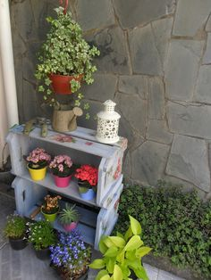 utilize small space: paint small crates, bright colored plant holders