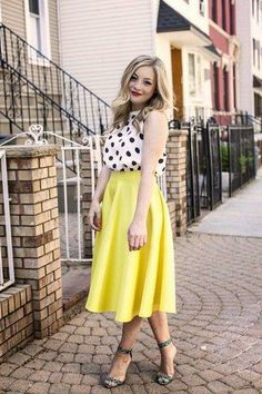 A bright lemon-y midi skirt pairs perfectly with polka dots on Rachel M. #stylegallery