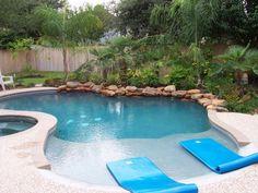 Freeform pool spa travertine decking pool outdoor for 50000 pool design