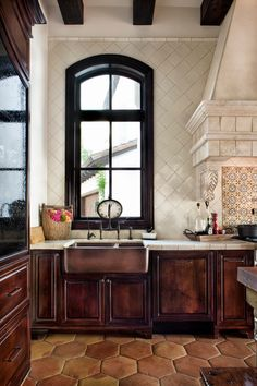 Got to have the puffy terracotta floor tiles! Tile walls, puffy terracotta floor tiles, copper farm sink, tall window, beautiful architectural details via: Jauregui Architecture-Interiors House Styles, House Design, Sweet Home, Interior, New Homes, Spanish Style Kitchen, Home Decor, Interior Architecture, Spanish Style Decor
