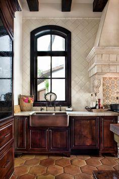Tile walls, puffy terracotta floor tiles, copper farm sink, tall window, beautiful architectural details via: Jauregui Architecture-Interiors